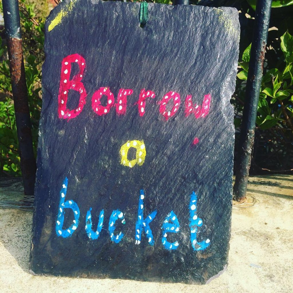 Sign reading 'Borrow a bucket'