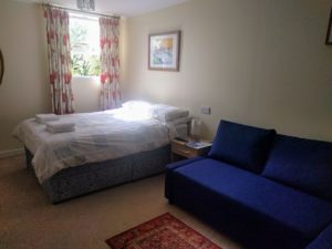 View of room showing double bed and sofa