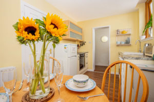 Sunflowers in focus against a kitchen
